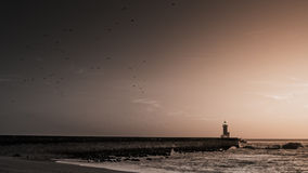 Lighthouse at sunset in BW Royalty Free Stock Image