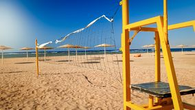 Beautiful photo of beach volleyball field at windy sunny day. Active sports on summer holiday vacation. Beautiful image of beach volleyball field at windy sunny royalty free stock photos