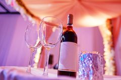 Beautiful photo of the Jewish Hupa , wedding putdoor . Two glasses and bottle of wine and glass it is wrapped in a foil Royalty Free Stock Photography