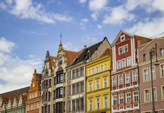 Beautiful photo of an old town in Wroclaw. A nice photo of a an old town in Wroclaw with colorful buildings and sky stock images