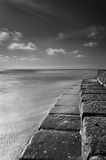 Sea stairs in contact with the seawater in black and white Stock Photos