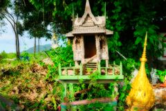 Small dilapidated temple in nature stock image