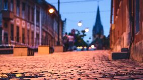 Beautiful photo of sibiu street with selective focus and evangelical church in background at twilight.  Royalty Free Stock Image