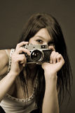 Beautiful Photographer, Focus On Camera, Sepia Stock Image