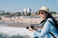 Beautiful photographer relaxing nearby the beach stock images