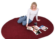 Beautiful Photographer Viewing Portraits On The Floor Royalty Free Stock Photos