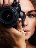 Beautiful photographer woman with camera Royalty Free Stock Photo