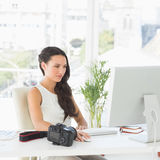 Beautiful photographer working at her desk Stock Photos