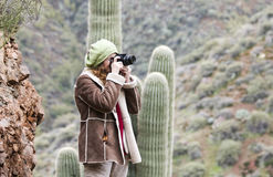 A Beautiful Photographer Works in the Desert Stock Photography