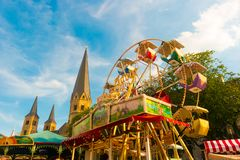 Beautiful picture of amusement rides and cathedral in Bonn, Germany stock photos