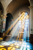 Beautiful picture of the church cross for Easter. The beams of light are shining through the mosaic inside of the church Royalty Free Stock Photography