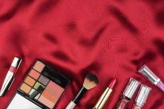 Beautiful picture of cosmetic  on red satin Stock Photos