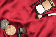 Beautiful picture of cosmetic  on red silk Stock Photo