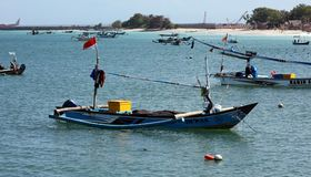 Beautiful picture of fishing boats at Jimbaran Bay at Bali Indonesia, beach, ocean, fishing boats and airport in photo. royalty free stock photos