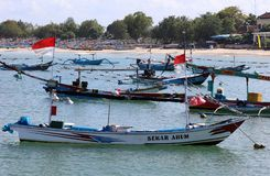 Beautiful picture of fishing boats at Jimbaran Bay at Bali Indonesia, beach, ocean, fishing boats and airport in photo. stock photography
