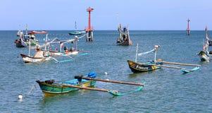Beautiful picture of fishing boats at Jimbaran Bay at Bali Indonesia, beach, ocean, fishing boats and airport in photo. royalty free stock image
