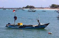 Beautiful picture of fishing boats at Jimbaran Bay at Bali Indonesia, beach, ocean, fishing boats and airport in photo. stock photo