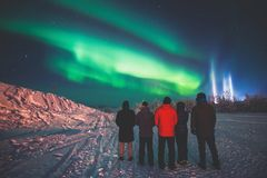 Beautiful picture of massive multicolored green vibrant Aurora Borealis, also known as Northern Lights in the night sky over winte stock photos