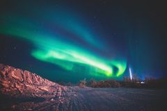 Beautiful picture of massive multicolored green vibrant Aurora Borealis, also known as Northern Lights, Sweden, Lapland Stock Photography
