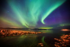 Beautiful picture of massive multicolored green vibrant Aurora Borealis, Aurora Polaris, also know as Northern Lights in Norway. Beautiful picture of massive Stock Photography