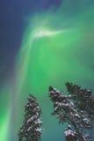 Beautiful picture of massive multicolored green vibrant Aurora Borealis, Northern Lights Stock Photo