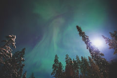 Beautiful picture of massive multicolored green vibrant Aurora Borealis, Northern Lights Royalty Free Stock Image