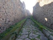 Roman Road at Pompeii Ruins stock photo