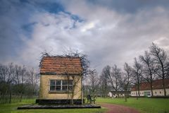 Small fairytale house with cloudy sky. stock image