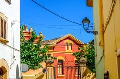 Beautiful, picturesque street, narrow road, colorful facades of Royalty Free Stock Image