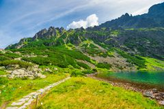 Beautiful picturesque Tatry Mountains and Lake. Czarny Staw stock image