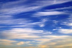 Beautiful picturesque white clouds against blue and yellow sky, magic background royalty free stock photo