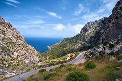 Beautiful picturesque winding road of Spain summer coast and Mediterranean sea with tunnel.  Stock Photo
