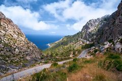 Beautiful picturesque winding road of Spain summer coast and Mediterranean sea with tunnel.  Royalty Free Stock Photography