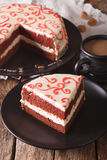 Beautiful piece of red velvet cake on a plate closeup. vertical Stock Photo