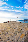 Beautiful pier scene at sunset. As seen at Molo Audace in Trieste, Italy stock photography