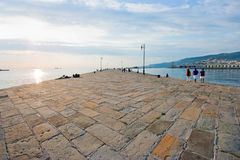 Beautiful pier scene at sunset. As seen at Molo Audace in Trieste, Italy royalty free stock photography