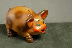 Beautiful piggy bank on a green background stock photo