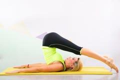 Free Beautiful Pilates Instructor With Yellow Yoga Mat Royalty Free Stock Photo - 31380645