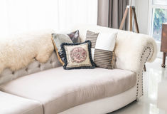 Beautiful pillow on sofa. Interior decoration in living room Stock Photo