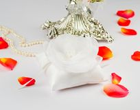 Beautiful pillow for wedding rings with rose Royalty Free Stock Photography