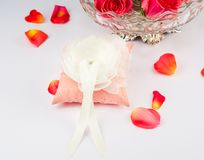 Beautiful pillow for wedding rings with rose Royalty Free Stock Photo