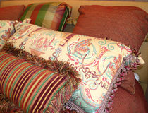 Beautiful Pillows. Variety of pillows on bed royalty free stock images