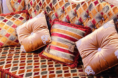 Beautiful pillows on a magnificent sofa Stock Photography