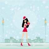 Beautiful pin-up girl in Christmas inspired costume Royalty Free Stock Image