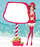 Beautiful pin-up girl in Christmas inspired costume Royalty Free Stock Photography