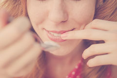 Beautiful Pin-Up Girl eating ice cream, close up Stock Photography