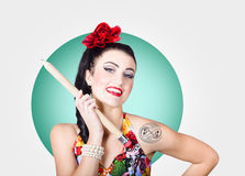 Beautiful pin-up girl getting skull tattoo stencil Royalty Free Stock Images