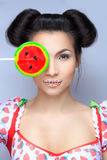 Beautiful pin-up girl holding sweet lollipop Stock Images