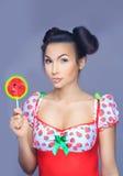 Beautiful pin-up girl holding sweet lollipop Royalty Free Stock Photos