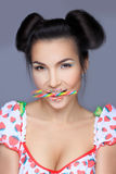 Beautiful pin-up girl holding sweet lollipop Royalty Free Stock Photo